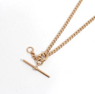 9ct yellow gold Albert chain with T bar, weighing 33.65 grams, 16 inches. £1,250.00