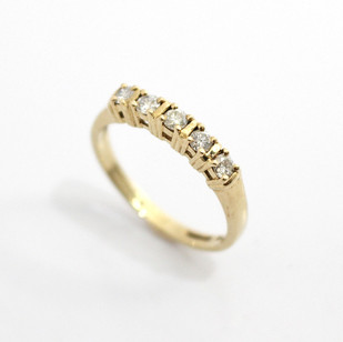 9ct yellow gold mounted diamond five stone claw set half hoop eternity ring. Total diamond weight 0.30ct. £385.00