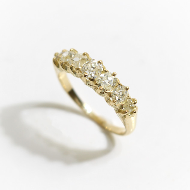 18ct yellow gold seven stone diamond ring. The 19th century old cut diamonds totalling approximatelly 1.45cts, set in an early 20th century gold mount. £1,850.00