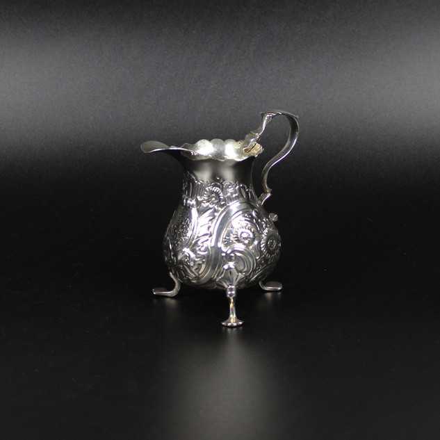 Rococo style cream jug. London 1746 £380.00