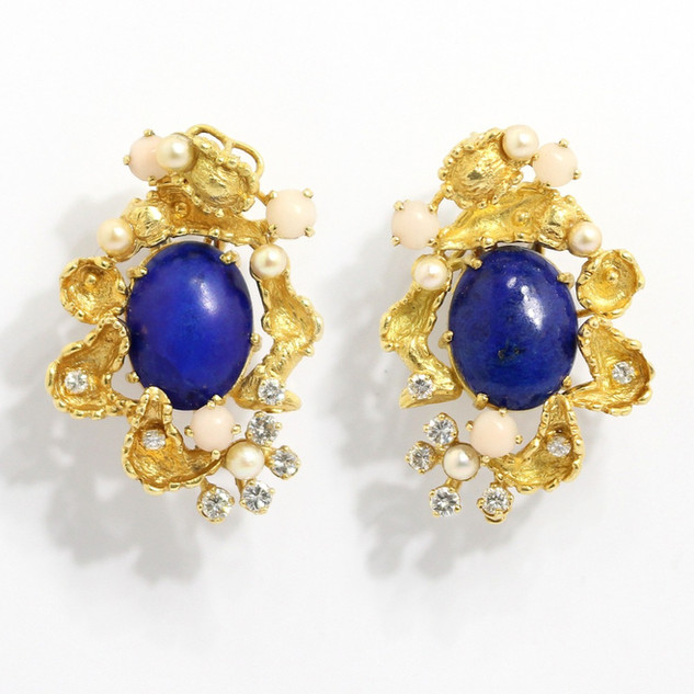 18ct yellow gold lapis, diamond, pearl and angel skin pink coral earrings. Comprising of a central oval cabochon lapis panel at centre of fancy 'rock pool' design border. Completed with diamonds, pearls and coral of textured naturalistic form by Lalaounis. 1960s/1970s. Clip and post fittings. High quality manufacture. £6,500.00