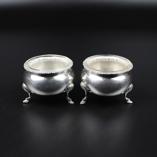 Dublin  Maker: R.S. 1912   Pair salts on shell hoof feet with clear glass liners.  5 ½ oz £ 200.00