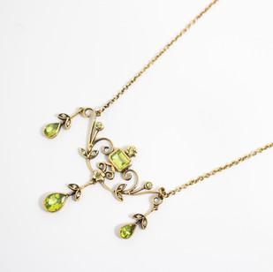 9ct yellow gold mounted Edwardian style peridot and diamond multi drop pendant necklace. £650.00