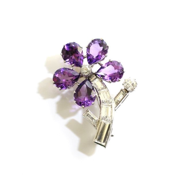 A unique 18ct white gold calibre cut diamond and amethyst flower brooch. Total amethyst weight 3.75cts, total estimated weight of diamonds 2.30cts. In a Grey-Harris & Co fitted case. £3,250.00