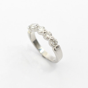 Platinumfive stone diamond ring. The brilliant cut diamonds totalling 1.10cts. With diamond points between totalling 0.06ct. £5,250.00