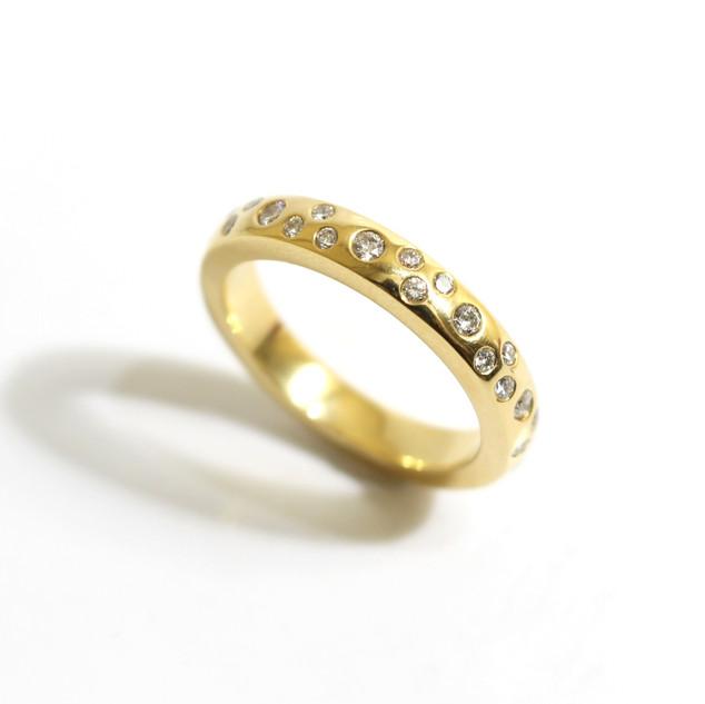 18 ct gold diamond scatter set ring. Diamonds 0.66 ct, G colour, Vs1.   £3,000.00