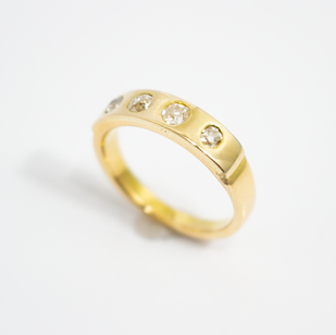 18ct yellow gold diamond ring. Comprising of a broad central ring set with four old cut diamonds. £575.00