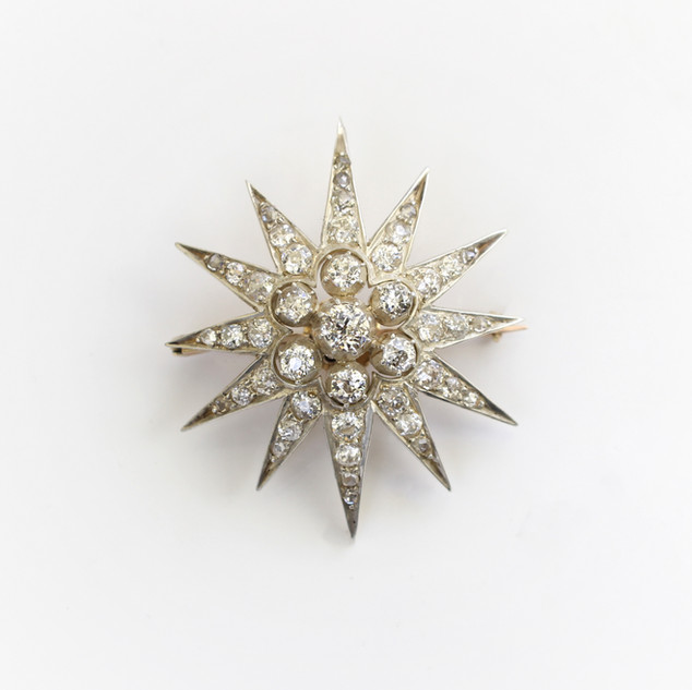 Late Victorian gold mounted and silver fronted diamond star brooch. Comprising of old cut diamonds, total diamond weight estimated 3cts. Provision for wear as pendant. Circa 1890. £3,750.00