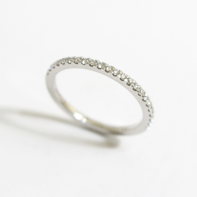 A platinum diamond set half eternity ring. Total weight of brilliant cut diamonds 0.23ct. £1,150.00