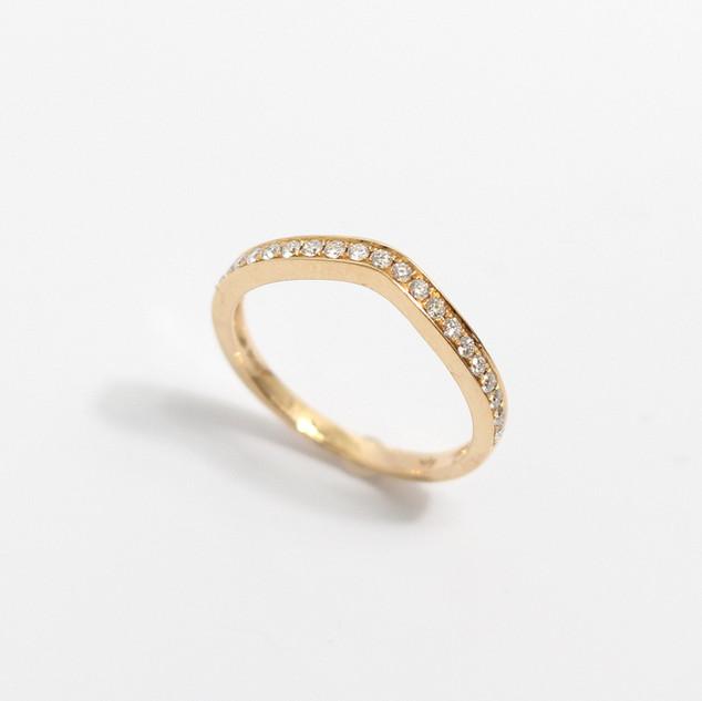 A 18ct rose gold wishbone diamond wedding band. The diamonds 0.20ct. £750.00