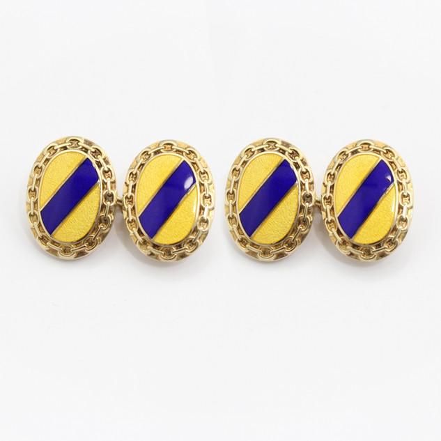 Silver gilt and enamel cufflinks. Yellow and blue stripe with chain decoration border. £175.00