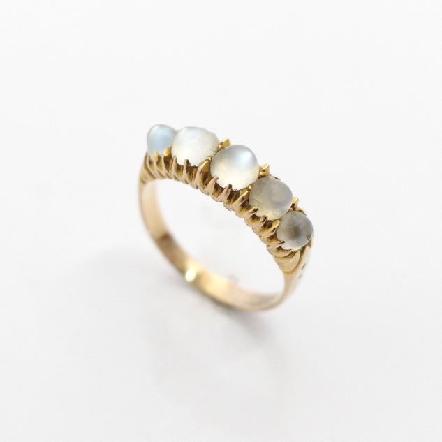 15ct yellow gold unusual Moon stone five stone half hoop ring. Circa 1900. £375.00