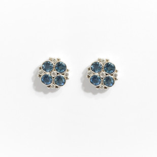 18ct white gold aquamarine and diamond fancy cluster earrings. Comprising of four circular aquamarine stones of fine intense colour, completed with small diamonds between. Total aquamarine weight 1.45ct, diamond 0.06ct.  £2,500.00