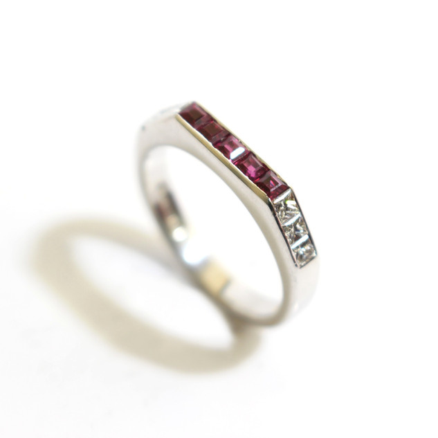 18ct white gold ruby and diamond half eternity ring. Total weight of rubies 0.44ct, total diamond weight 0.38ct, G colour, Vs1 clarity. £1,500.00