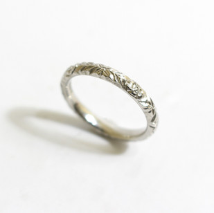 A platinum hand carved ring.  Grey-Harris & Co hallmark. Also available in 22 and 18ct gold. £675.00