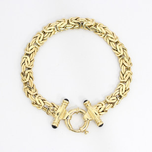 14ct yellow gold fancy link bracelet with cabochon sapphire featured clasp. £750.00