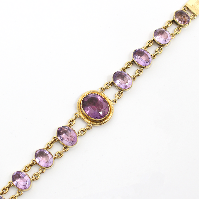 18ct yellow gold and amethyst bracelet. Circa 1890/ The foiled backed amethysts of graduating size and colour. In fine order. £2,250.00