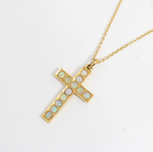 18ct yellow gold Edwardian opal set gold cross on a 18ct yellow gold chain. £675.00