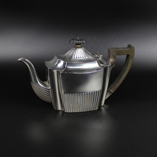 Martin Hall & Co - Sheffield 1896  Part fluted rectangular pot within curved corners. Engraved with arms and crest   £300.00
