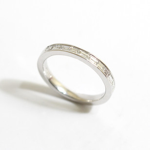 Platinum and baguette diamond half eternity ring. Diamonds 0.51 ct. G colour, Vs clarity. Channel set.   £3,200.00