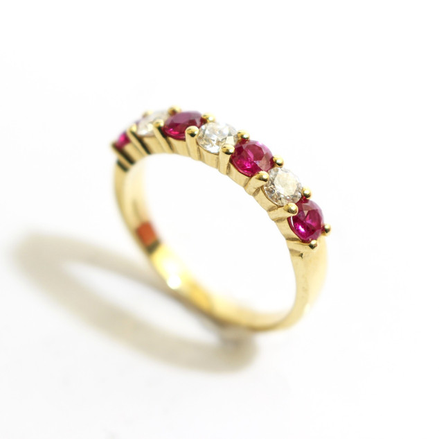 18ct yellow gold ruby and diamond half eternity ring. Total ruby weight 0.73ct, diamond weight 0.43ct, G colour, Vs1 clarity. £2,400.00