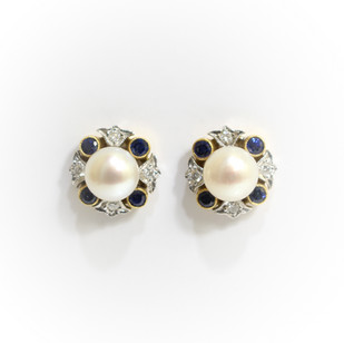 18ct yellow and white gold pearl, sapphire and diamond cluster earrings. The cultured pearls measuring 7mm. £1,450.00