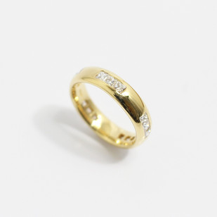 A heavy 18ct yellow gold 'Court' profile ring with French cut diamonds at points around the band. 1.06cts of diamonds, G colour, Vs clarity. £2,850.00