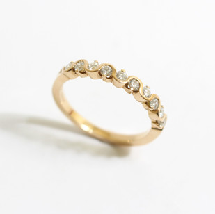 18ct rose gold diamond half eternity ring. The brilliant cut diamonds totalling 0.37ct, G colour, Vs1 clarity. To a wave and claw setting. £1,400.00  Available in 18ct yellow gold and platinum.