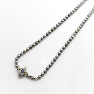 A necklace of silvery grey graduated cultured pearls. Completed with a fine diamond and sapphire clasp. Cased. £3,250.00