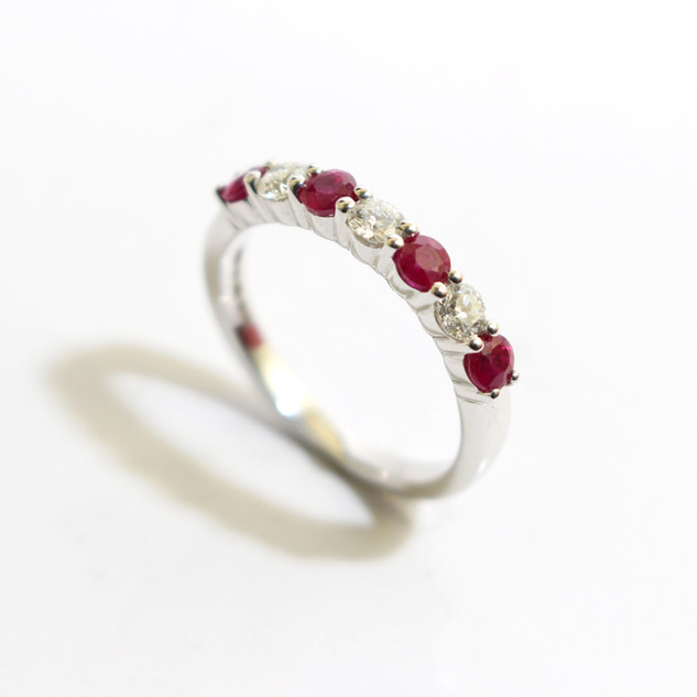 18ct white gold ruby and diamond half eternity ring. £1,350.00
