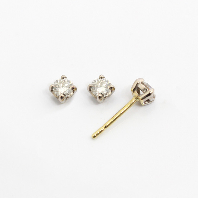 18ct yellow and white gold diamond stud earrings. The modern brilliant cut diamonds 0.25ct each, G colour, Si clarity. £1,850.00