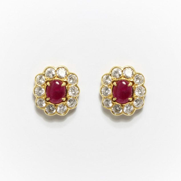 18ct yellow gold ruby and diamond custer earrings. With cabochon ruby centres and brilliant cut diamond surrounds totalling 1ct. £2,500.00