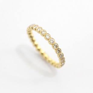18ct all yellow gold diamond full eternity ring. The diamonds in rub over millgrained settings. Total diamond weight 1.01ct. £2,850.00