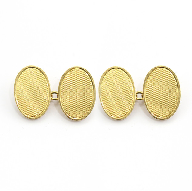 18ct yellow gold engine turned oval chain cufflinks. £1,000.00
