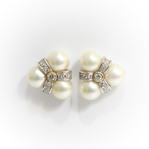 18ct white gold pearl and diamond stud earrings. £1,200.00