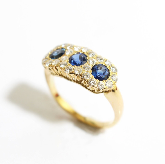 Edwardian 18ct yellow gold triple sapphire and diamond cluster ring. £2,500.00