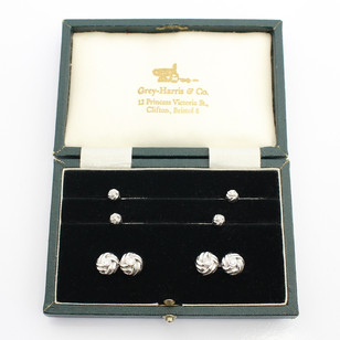 18ct white gold and diamond dress set. The complete set comprising of knot cufflinks and studs each set with a brilliant cut diamond. Cased. £2,250.00