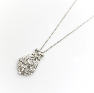 18ct white gold diamond set garland pendant. Completed on a 18ct white gold spiga chain. £1,850.00