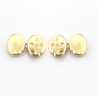 9ct yellow gold, domed oval cufflinks. The feature panel set with a brilliant cut diamond and display hallmarks. £800.00