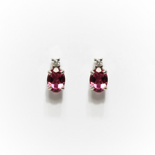 18ct white gold tourmaline and diamond stud earrings. The tourmalines totalling 1.37cts. £850.00