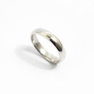 A platinum 'Court' profile heavy weight wedding ring. Grey-Harris & Co hallmark. Most wedding rings are priced by weight. This example is 4mm width and is a size R . £970.00 Please enquire for alternative price and sizing.