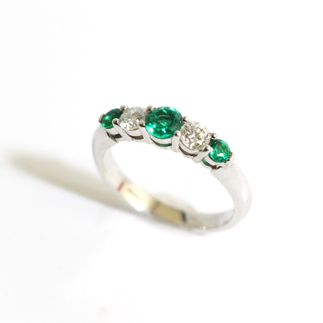 A platinum emerald and diamond five stone ring. The round brilliant cut stones of good colour and graduation. £4,000.00
