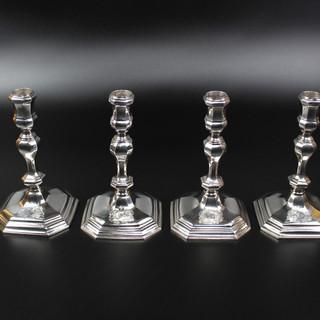 Set of four George I cast candlesticks. Anthony Nelme, 1717.  £ 24,000.00