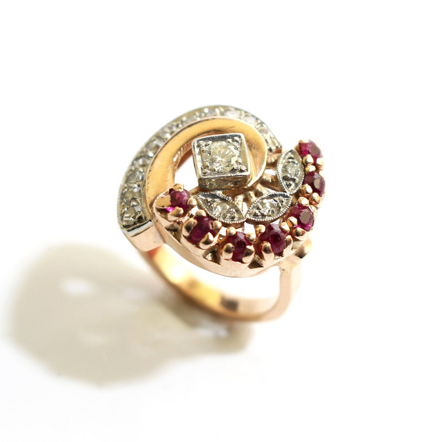 A large 14ct rose and white gold ruby and diamond dress ring. £850.00