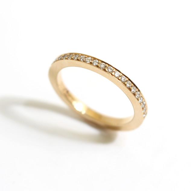 18ct rose gold diamond set half eternity ring. Total weight of brilliant cut diamonds 0.24ct. £1,200.00