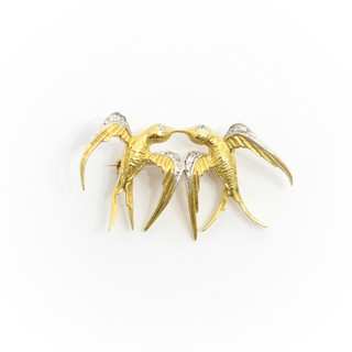 18ct yellow gold swallows brooch. The kissing swallows set with diamonds to the wings and head. £575.00