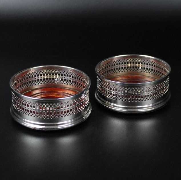 Wakely & Wheeler  Pair of bottle coasters  Pierced pattern   £650.00