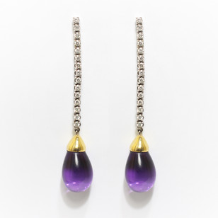 A pair of long 18ct yellow and white gold amethyst and diamond drop earrings. £3,250.00