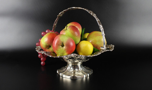 Henry Wilkinson Sheffield - 1837 Circular cake basket with swing handle  12 ½ diameter  38 oz  Vine and grape decoration  SOLD.