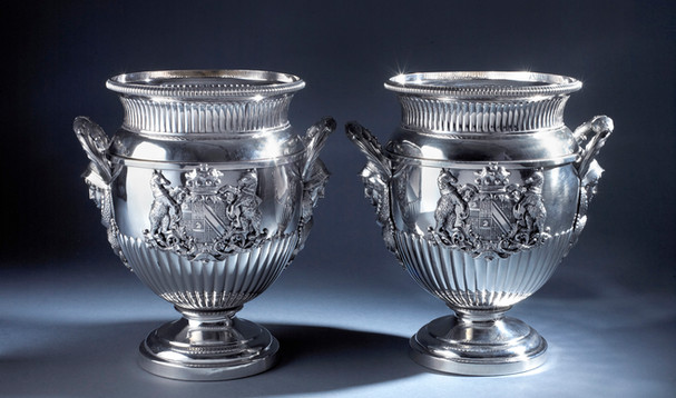 Pair of old Sheffield plate wine coolers 10 inches With applied silver handles and arms. The arms are those of Alexander Baring: He became the Baron Ashburton 1835. He subsequently lived with his daughter and son in law (probably the Earl of Bath at Longleat) until his death 1870s at Longleat. Head of the Banking family. The year he was raised to the peerage 1835 and hallmarked. Robert Garrard Reserved.